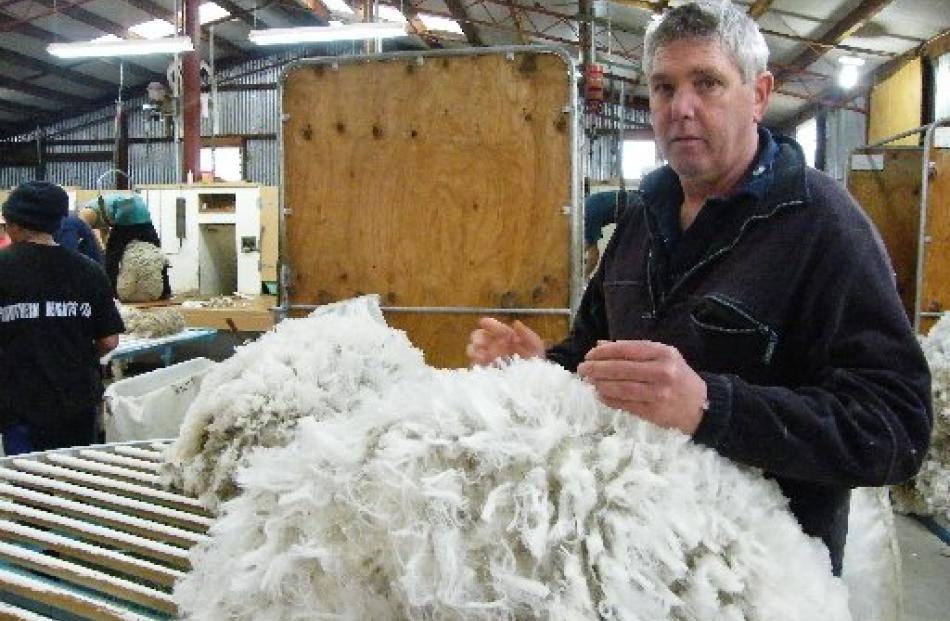 Wool classer Terence Mulcahy passes judgement on each fleece.