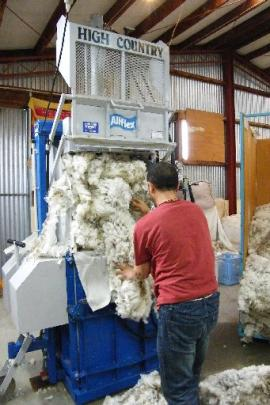 Wool is pressed into bales ready for shipment and sale. Photos by Ruth Grundy.