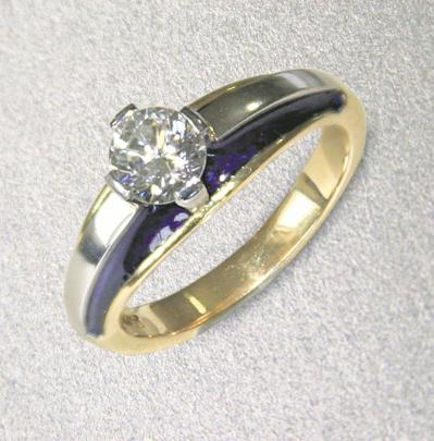 An 18ct gold and platinum diamond ring with blue enamel by Tony Williams.
