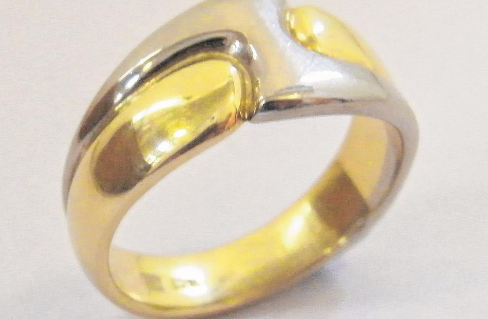 An 18ct yellow and white gold ``lightning flash'' ring by Tony Williams, which is popular as a...