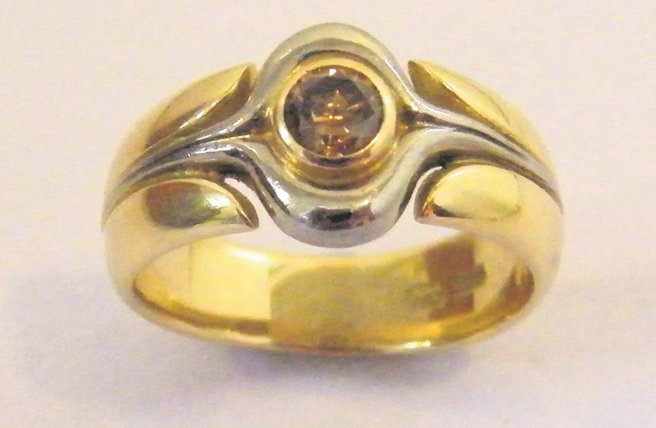 An 18ct yellow and white gold ring with cognac diamond, designed as a man's ring by Tony Williams.
