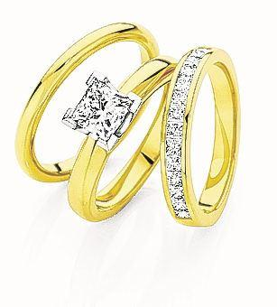 Canadian Fire princess cut diamond engagement, anniversary and wedding rings set at Daniels...