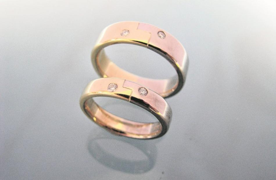 Yellow and white gold diamond wedding bands by Chris Idour.