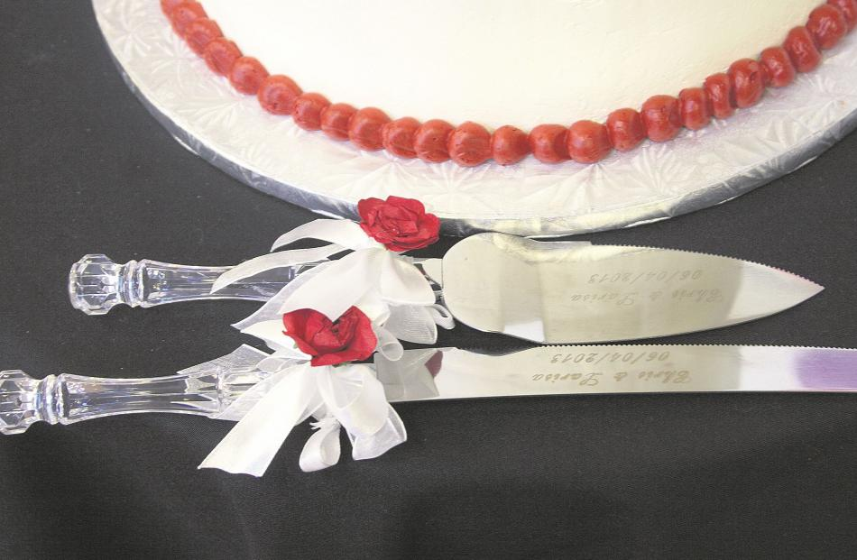 Christopher Swift and Larisa Matiagina's wedding cake cutlery.  MOIRA CLARK, M.PHOTOG, NZIPP, AIPP