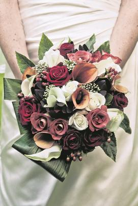 Sarah Davie's bridal bouquet for her marriage to Petros Nitis last year in the Orchard Gardens....