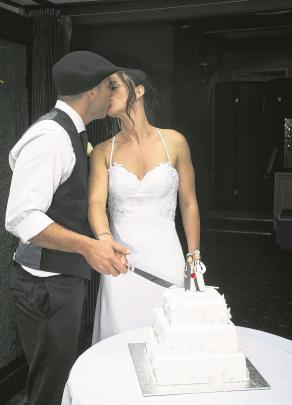 Sam and Tania Jenkins cut their wedding cake.