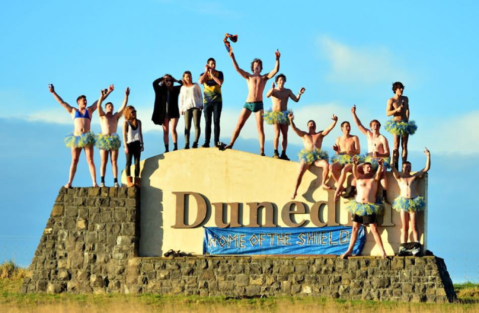 Supporters ready to salute the team bus from the Dunedin sign near Allanton.