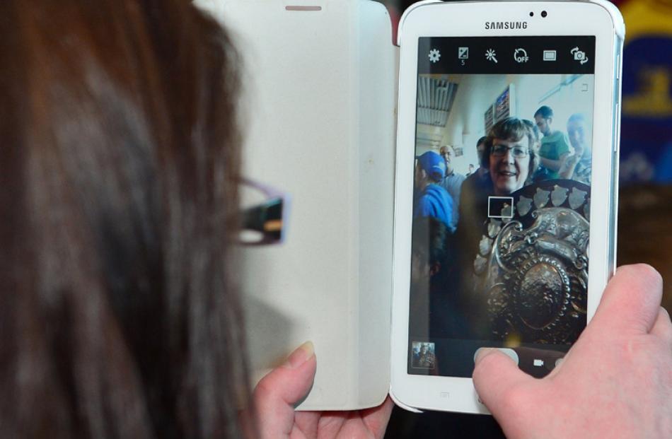 Kellie Donovan takes a photo of Lynne Campbell.