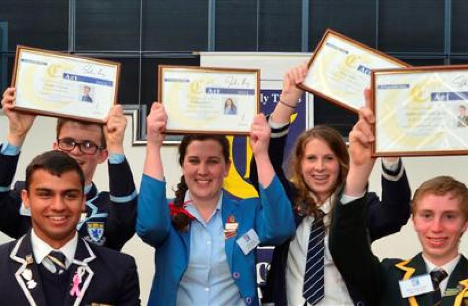 Holding their Class Act 2013 awards  for all to see are (from left) Columba College pupil Sian...