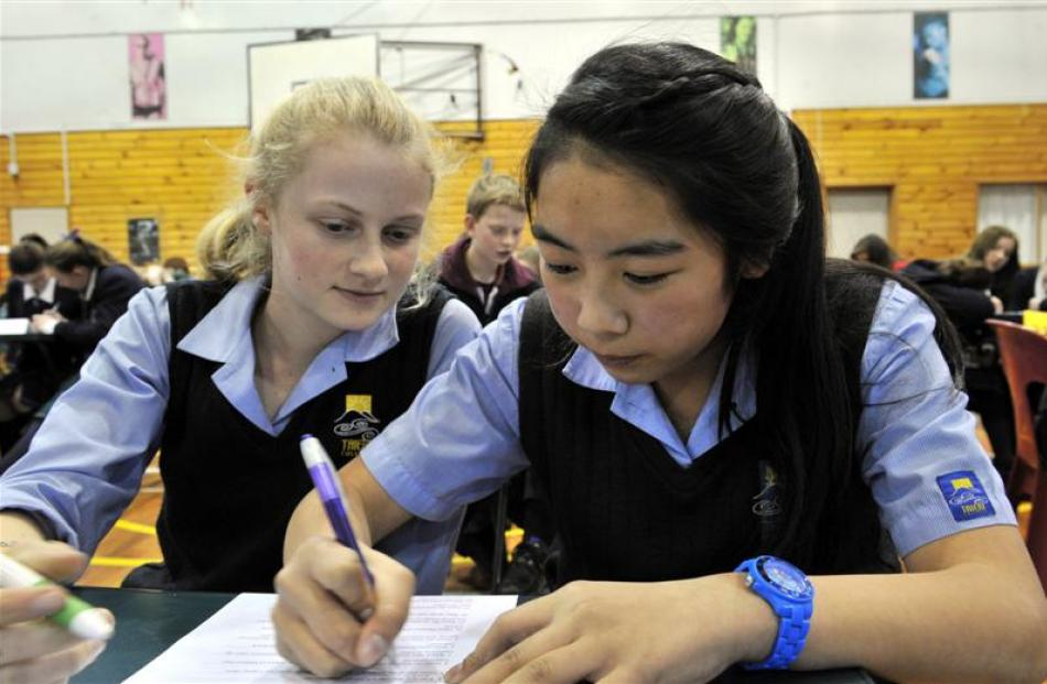 Write on   ...   Taieri College pupil Emily Hackfath (13) watches Kymberlee Choie (14) record an...