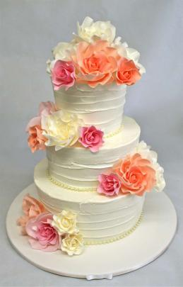More brides are coming back towards handmade flowers. Cake by Cakes of Wanaka
