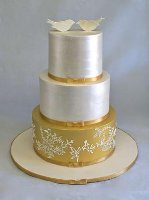 The cake should reflect the couple and what they are into, and their theming and colours of the...