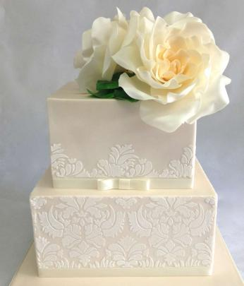 Tiered cakes offer more scope for design and also give a more modern look. Cake by Cakes of Wanaka