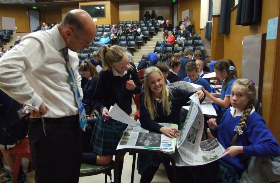 Cromwell College principal Mason Stetch keeps an eye on the progress of one of the college's...