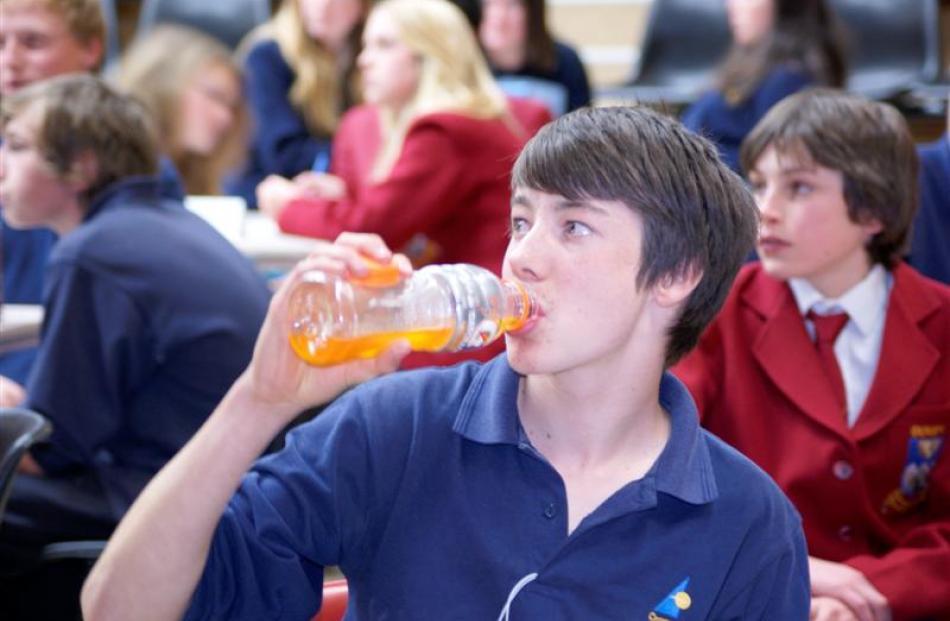 Lockey Scott (14), of Cromwell College,  rehydrates.