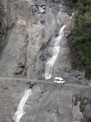 A camper van passes the Diana Falls slip  after a single lane  between Makarora and Haast was...