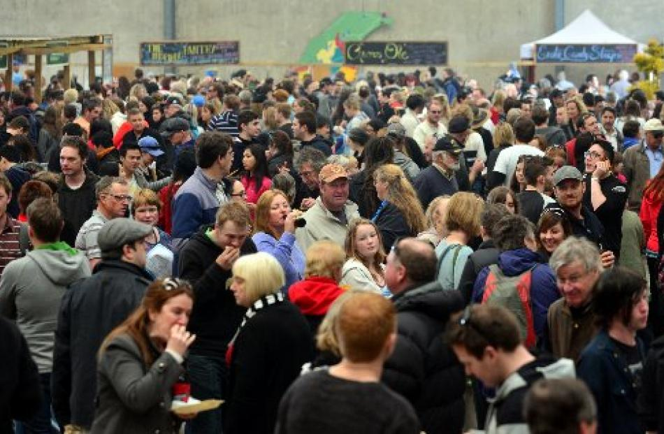 Crowds mingle and munch during the Port Chalmers Seafood Festival on Saturday.