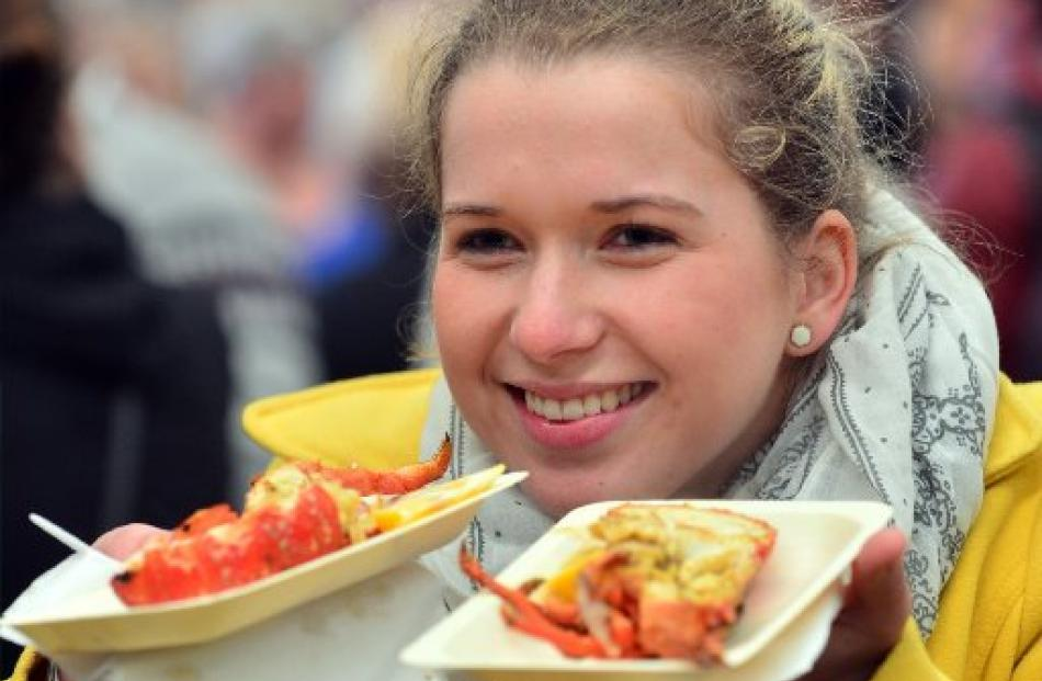 Katja Czieselsky (23) prepares to enjoy the crayfish on sale at the festival.