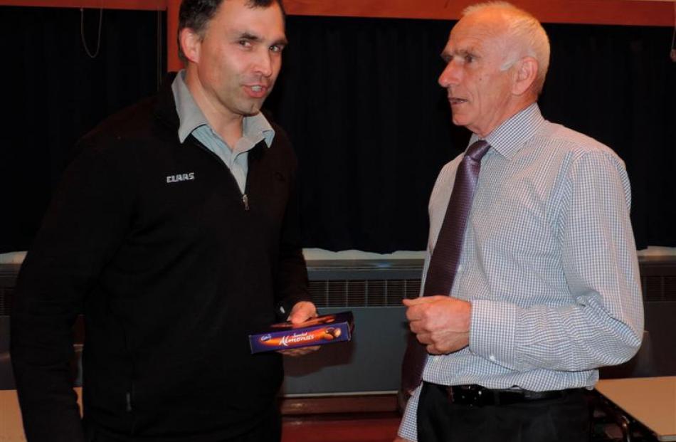 Ashburton's Allenton School board of trustees chairman Scott Parker  (left) receives a box of...