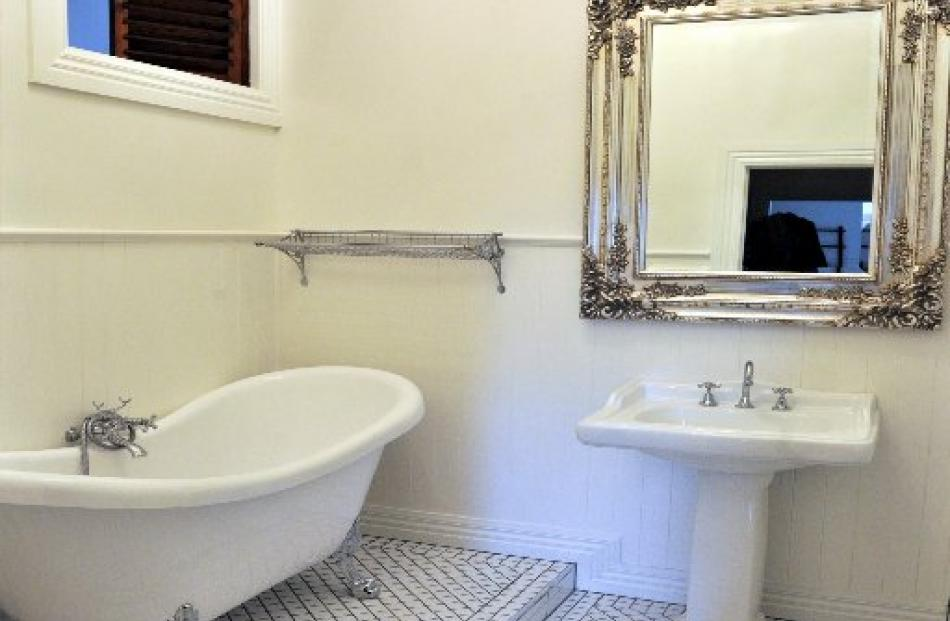 The ensuite bathroom with its clawfoot bath.  A fire engine bed has right of way in MacKenzie's...