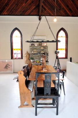 The furniture is a mix of old and new, rustic and industrial.