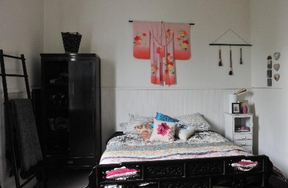 The main bedroom features oriental furniture and fabrics that Jaimee bought on a work-related...