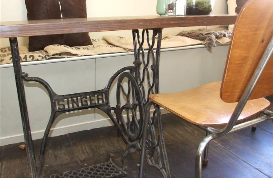 A Singer sewing machine base has been used to create a table.