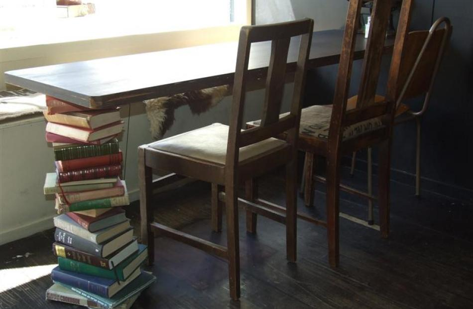 A table leg made from books.