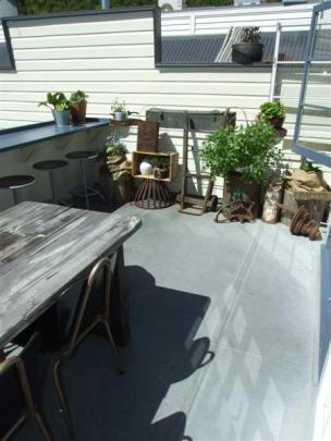 The outdoor dining area of the Chop Shop Food Merchants was designed to bring a slice of the New...
