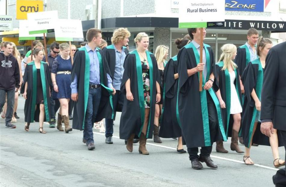 Telford graduands walk down Clyde St during the Telford graduation parade in Balclutha yesterday.