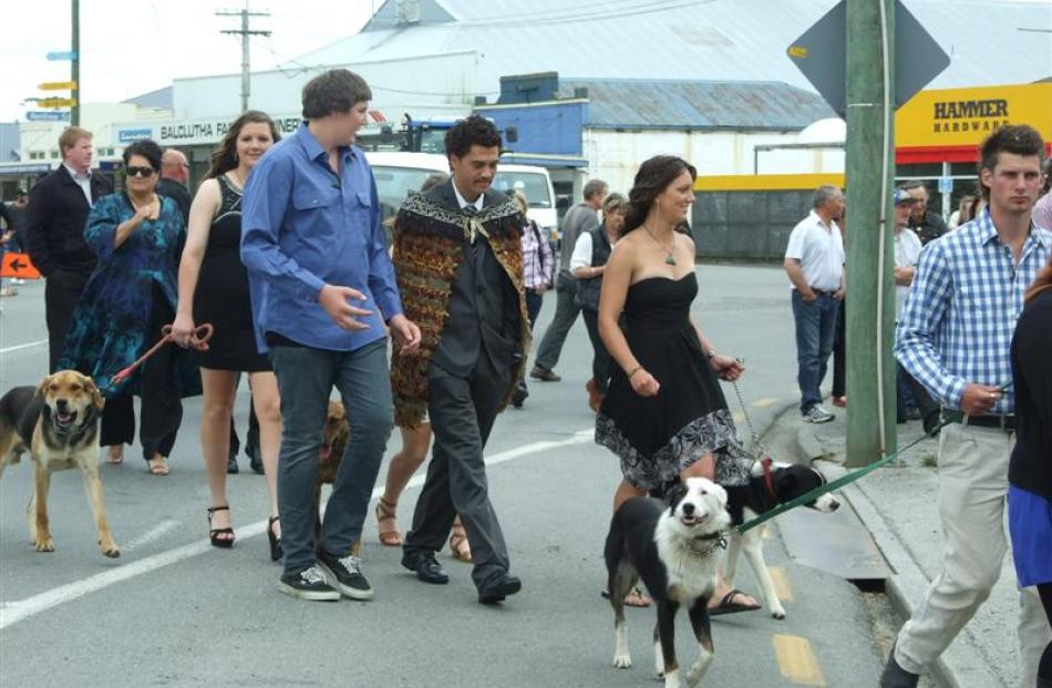 Telford graduands walk down Clyde St during the Telford graduation parade in Balclutha yesterday....