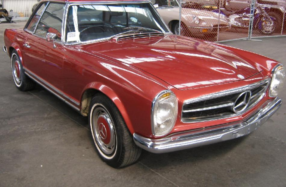 1969 Mercedes-Benz 280SL bought $65,000, sold for $58,000.