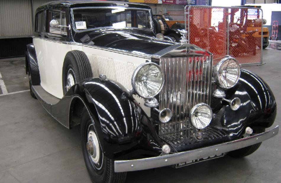 1938 Rolls Royce  Phantom III, bought for $200,000, sold for $97,100.
