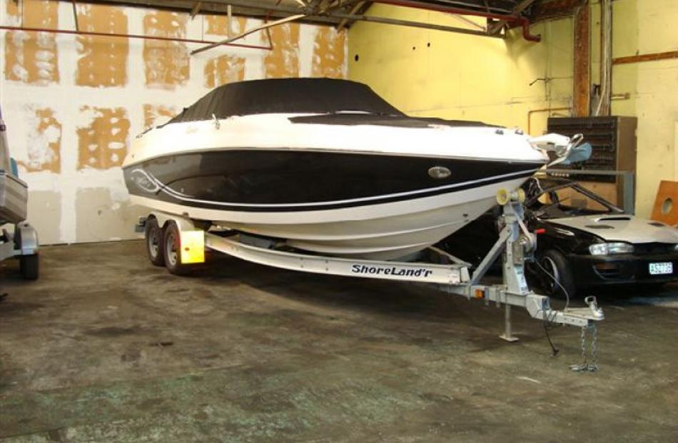 Rinker Captiva 282 boat and trailer, Bought $96,239 sold for $44,500.