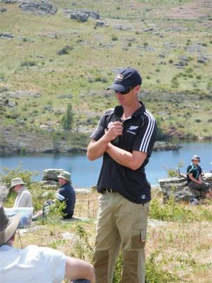 Duncan Campbell speaks during a lunch break to the about 300 people who attended a field day at...