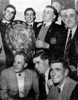 Members of the Otago team triumphantly display the Ranfurly Shield after the match at Athletic...