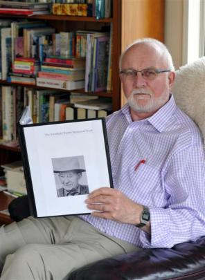 Retired schoolteacher Alan Jackson holds a photo of Archibald Baxter. Photo by Craig Baxter.