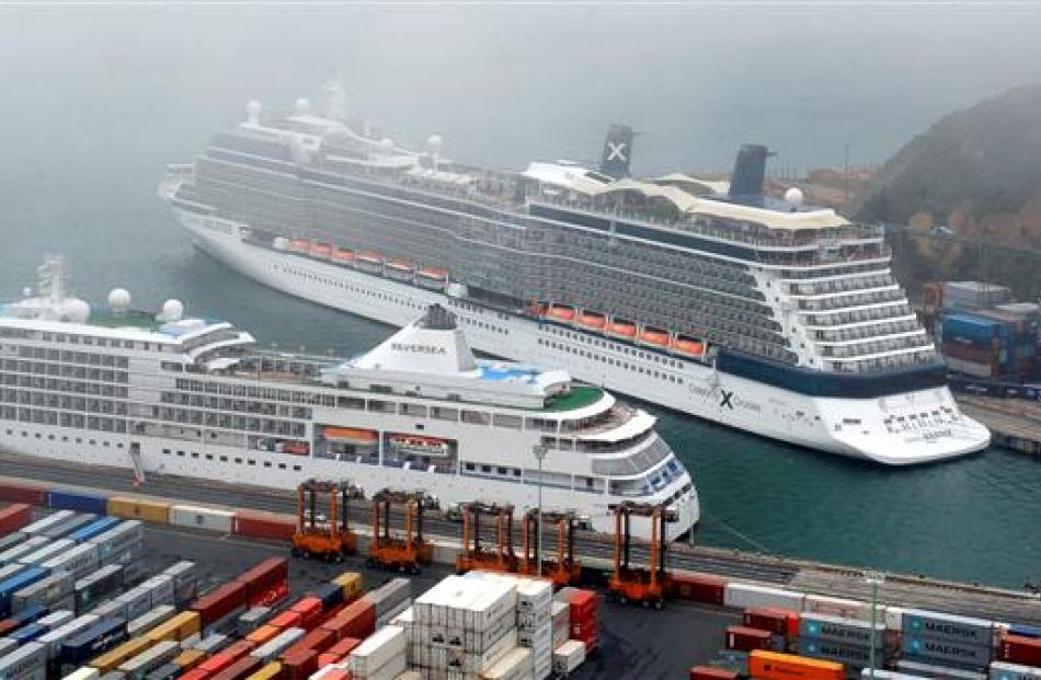 Cruise ships Celebrity Solstice (rear) and Silver Shadow.