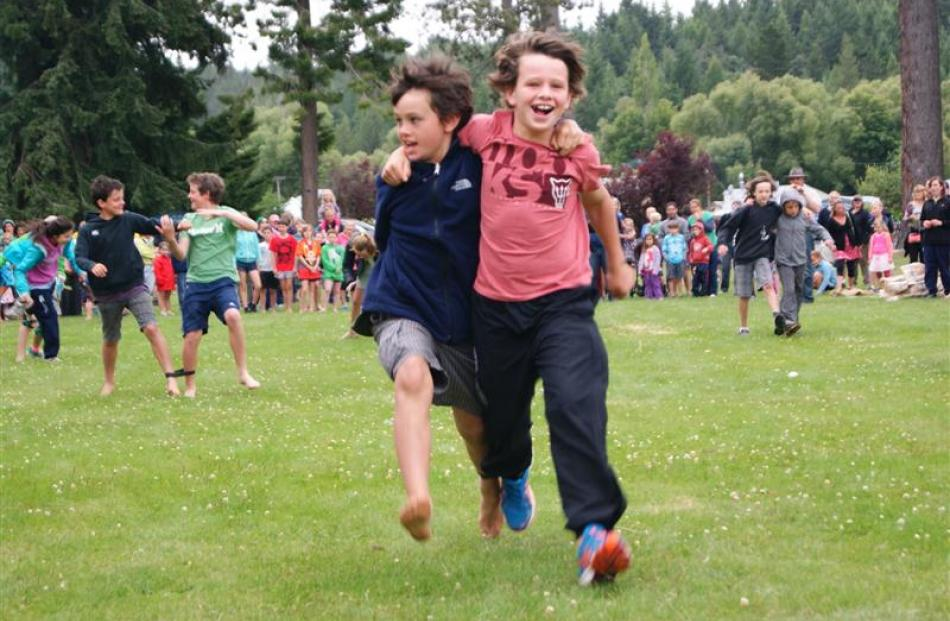 Isaac (9) and Elliot (11) Miller (pictured above), both of Mosgiel, prove the chilly weather and...