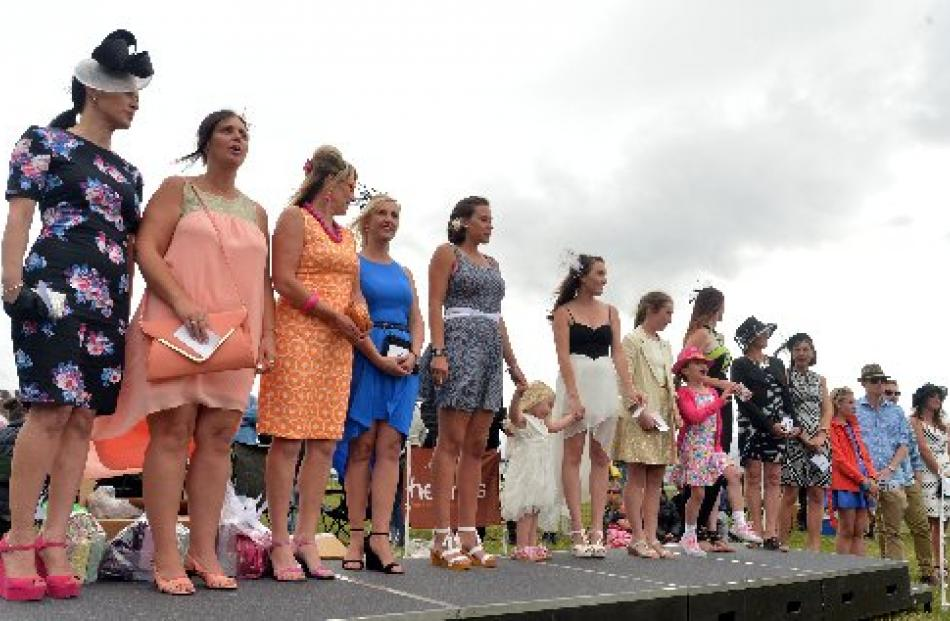 Fashions on  the Field contestants line up on the catwalk.