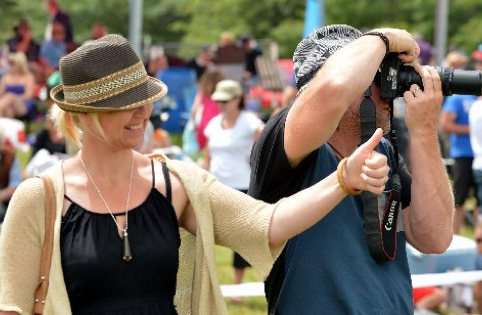 Jo Anne and Brook Grimwood, of Riverton, check out the action.