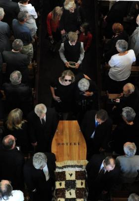 Artist Ralph Hotere's casket is carried from St Joseph's Cathedral in February.