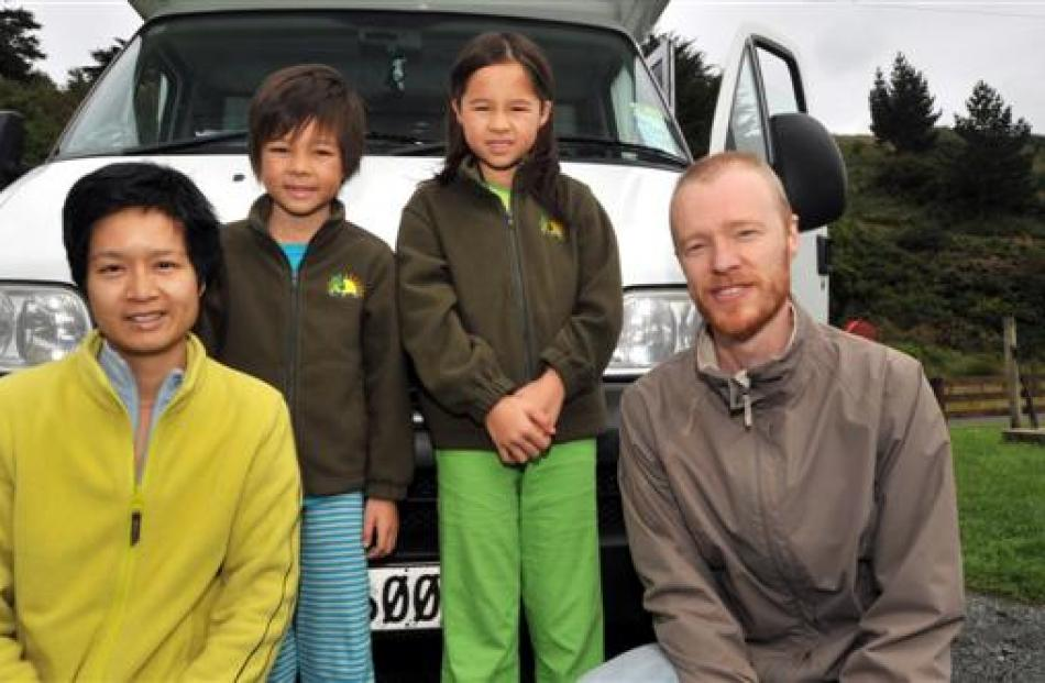 Tourists (from left) Josephine (40), Orin (7), Aoife (9) and Dhugal Meachem (41), of Hong Kong,...