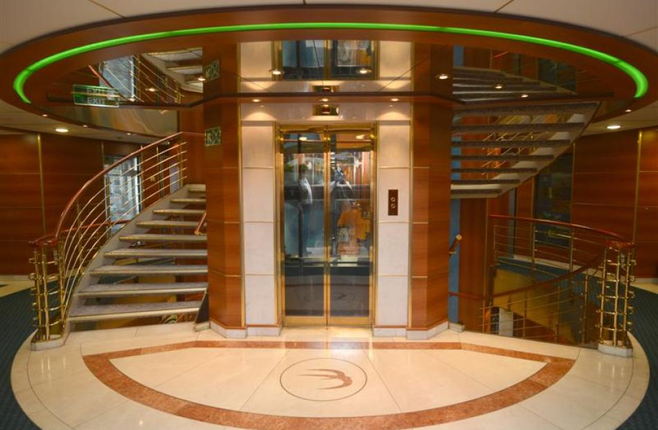 The main stairwell and glass lift.