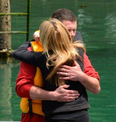 The skipper and owner of a boat which capsized off Otago Peninsula yesterday, John King, embraces...