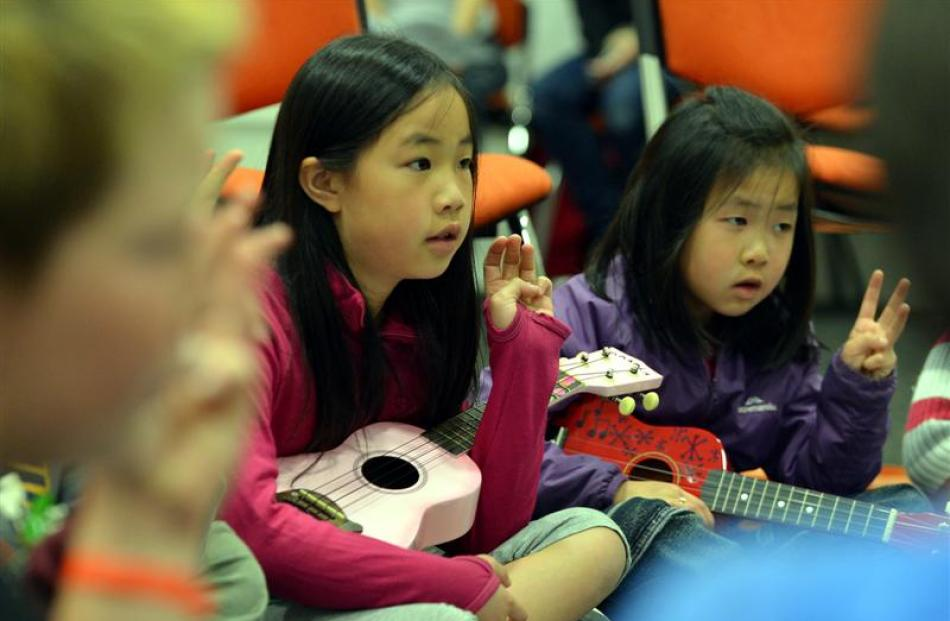 Mandy (9) and Chloe Lo (6) pay careful attention. Photos by Peter McIntosh.