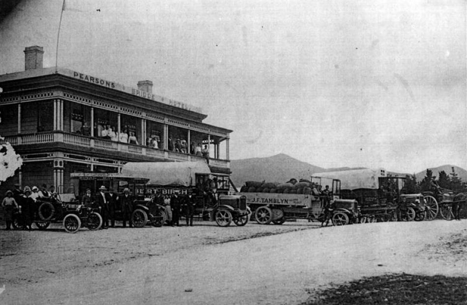 Vehicles are drawn up outside the former Bridge Hotel during activities to mark Armistice Day,...