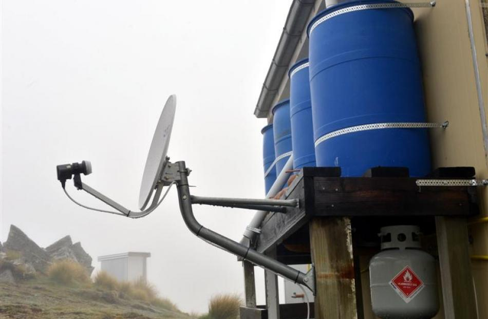 A Sky dish and long-drop toilet add to the hut's comforts.
