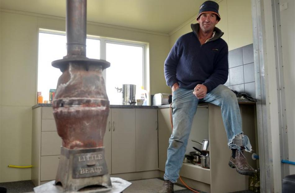 Neville Hore relaxes in the kitchen of his hut on Mt Alexander Station in Dansey Pass.