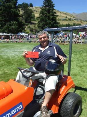 Alan McCrostie, of Alexandra, after winning the ride-on lawnmower race.